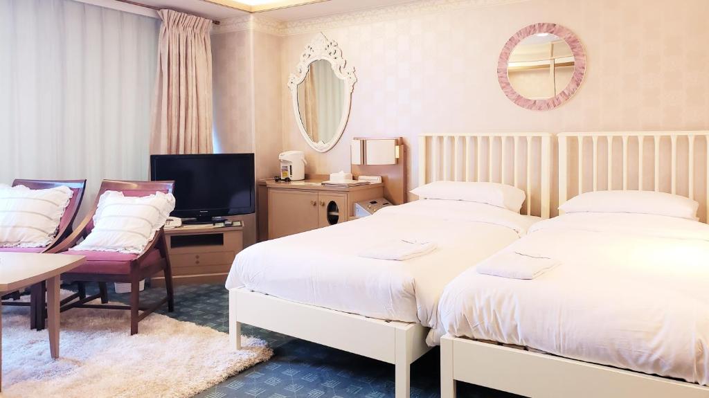 Tempat tidur dalam kamar di Hotel Heritage Hanno