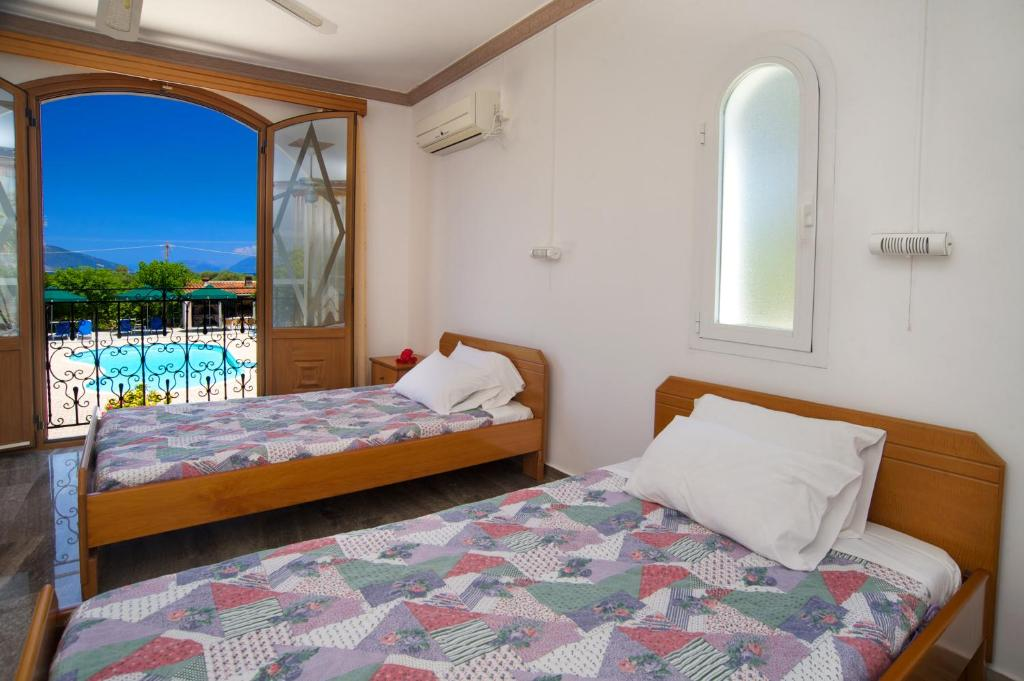 A Bed Or Beds In Room At Nikos Studios And Apartments