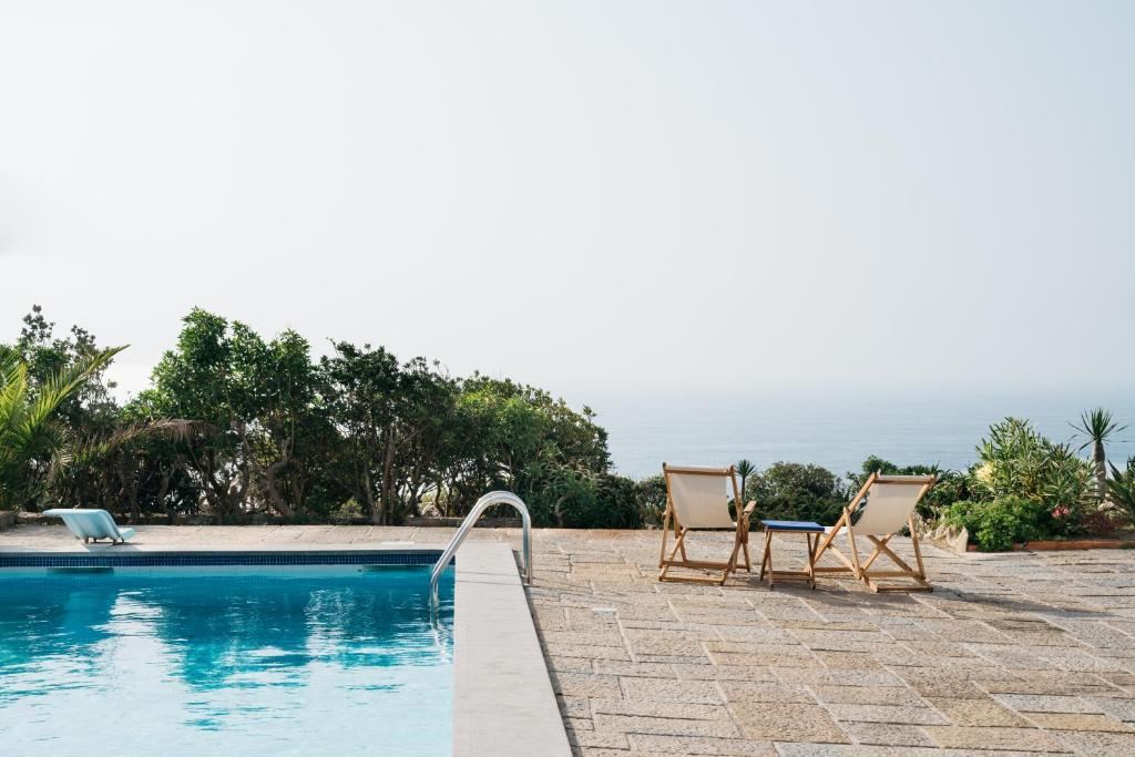 The swimming pool at or near OUTPOST - Casa das Arribas
