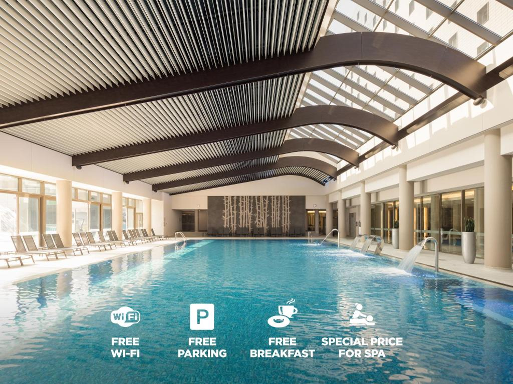 The swimming pool at or near Ramada Parc Hotel