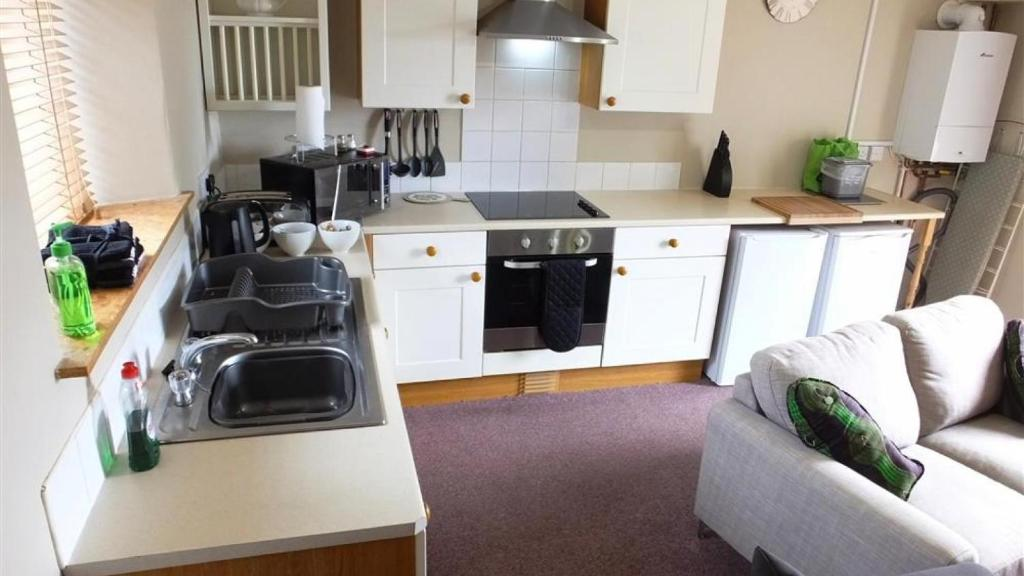 A kitchen or kitchenette at Cosheston Apartments 5