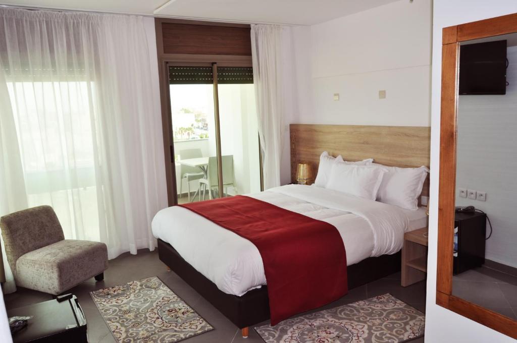 A bed or beds in a room at Dakhla Sur Mer Hôtel