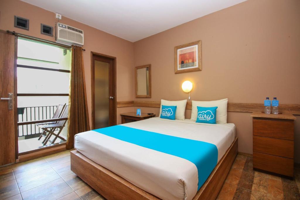 Tempat tidur dalam kamar di Airy Cigadung Raya Barat 9A Bandung