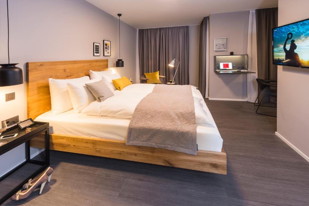Ein Bett oder Betten in einem Zimmer der Unterkunft Timehouse Serviced Apartments