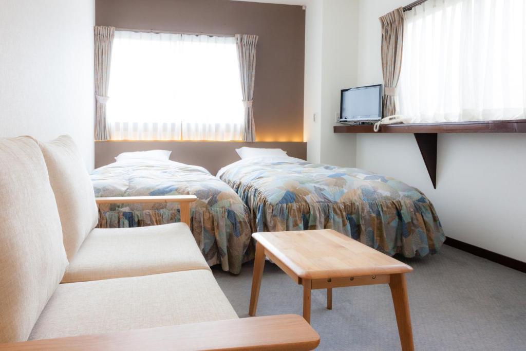 Een bed of bedden in een kamer bij Kyoto Ryokan Kinoe