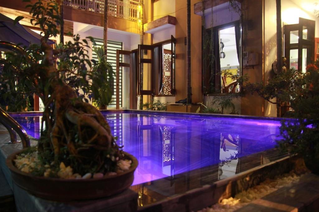 The swimming pool at or near Hoi An Golden Horse Villa