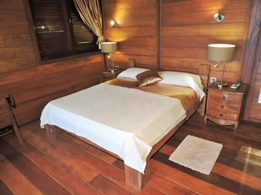 A bed or beds in a room at Bois Joli