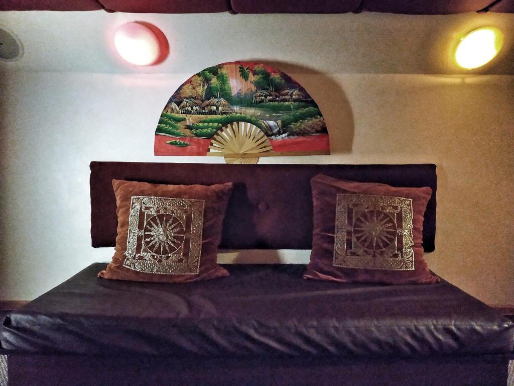 Кровать или кровати в номере Отель Мальта