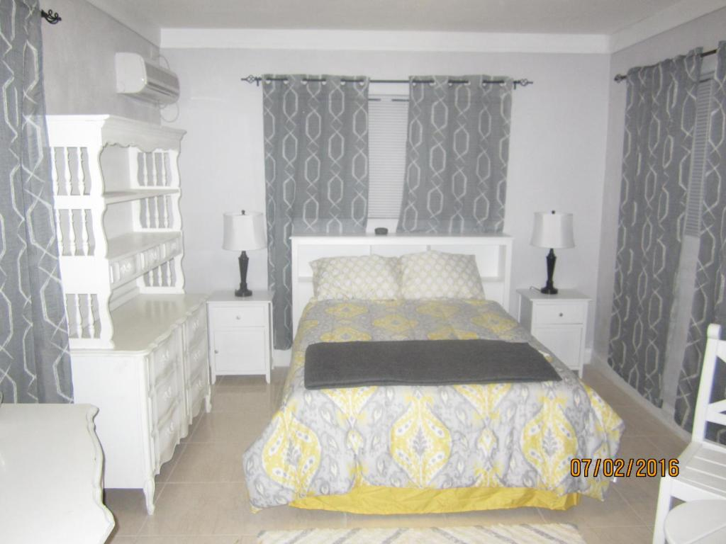 A bed or beds in a room at Tranquillity