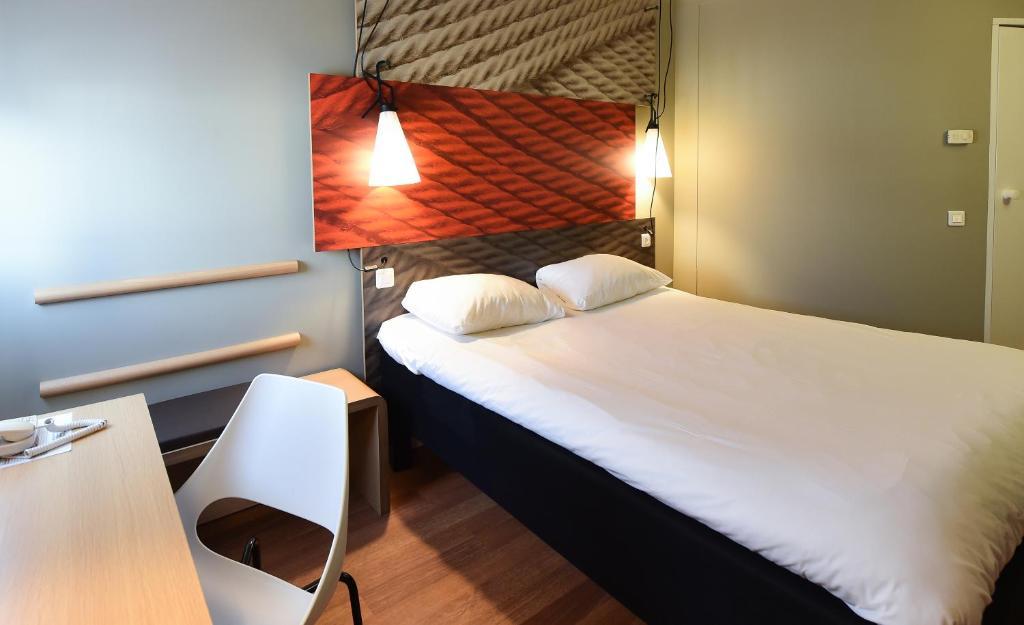 Un ou plusieurs lits dans un hébergement de l'établissement Hotel ibis Dijon Centre Clemenceau