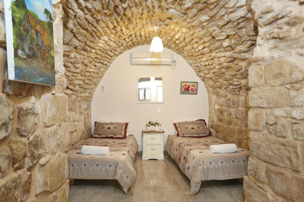 A bed or beds in a room at Zimmer in Safed Old City
