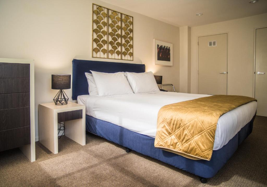 A bed or beds in a room at U Residence Hotel