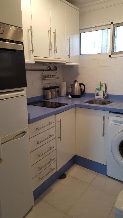 A kitchen or kitchenette at Apartment Montiboli