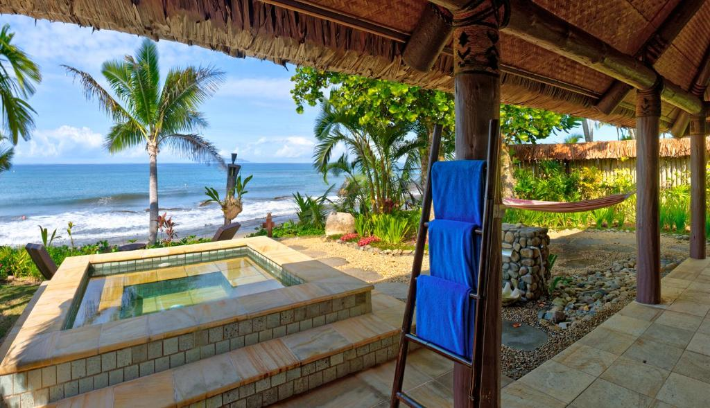 A view of the pool at Nanuku Auberge Resort Fiji or nearby