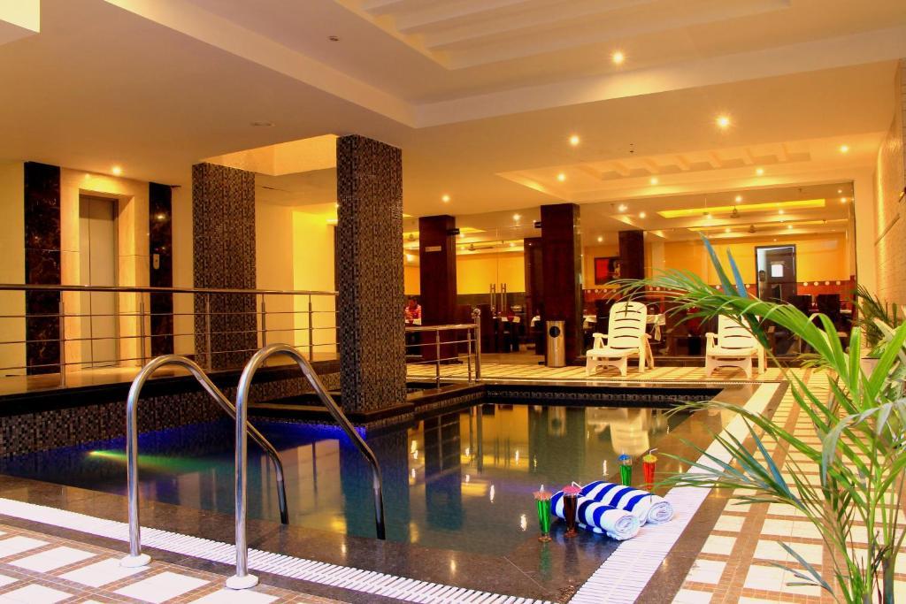 The swimming pool at or near Taj Villa
