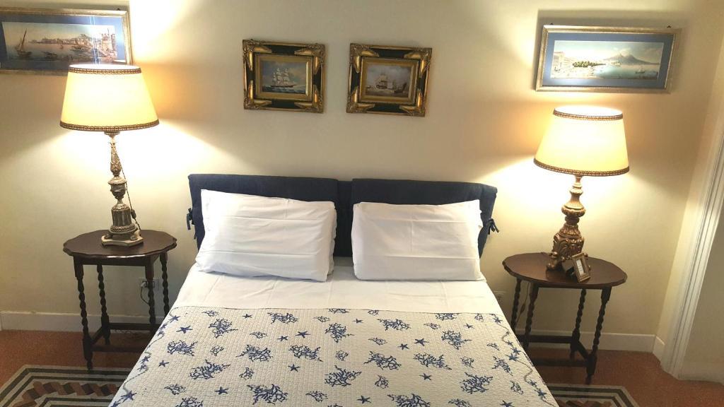 Uma cama ou camas num quarto em Paola A Trastevere