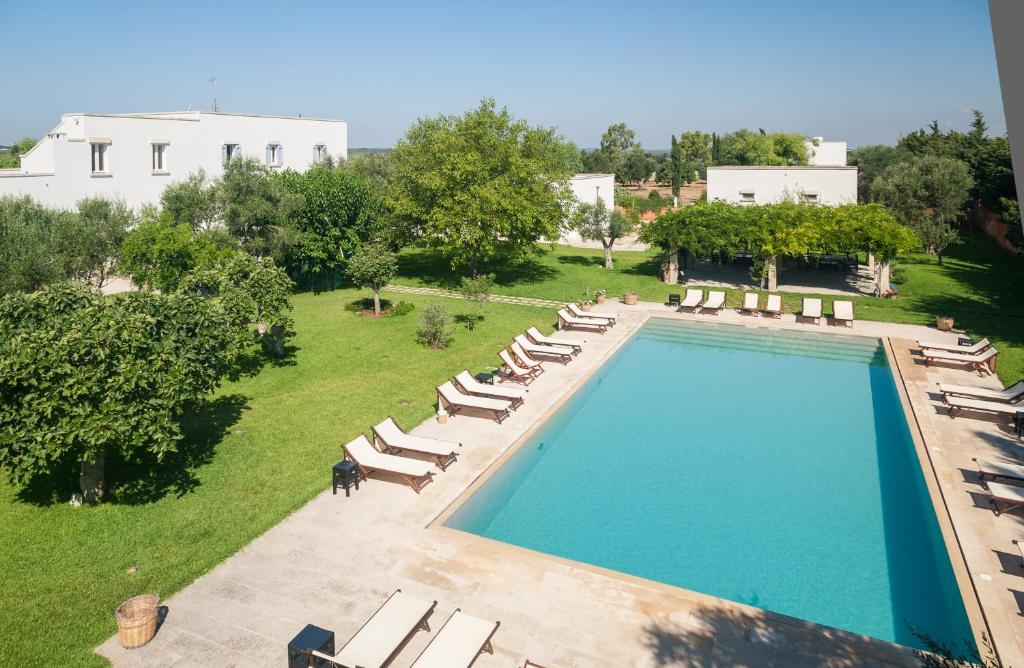 A view of the pool at Masseria Montelauro or nearby