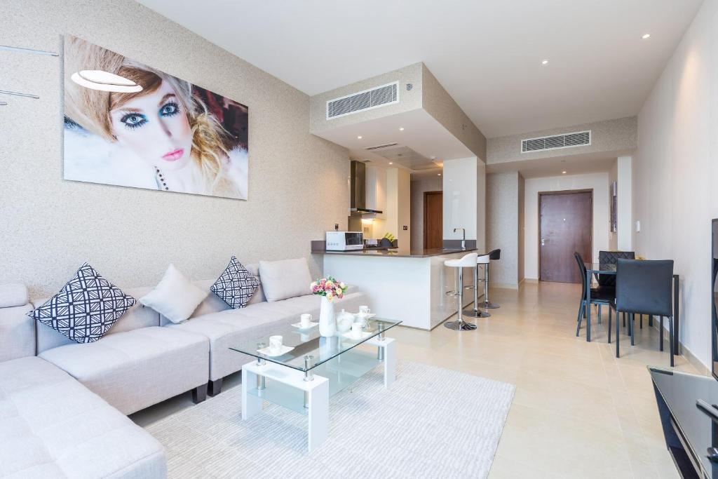 A Seating Area At 2 Bedroom Apartment In The Residences Marina Gate By Deluxe Holiday