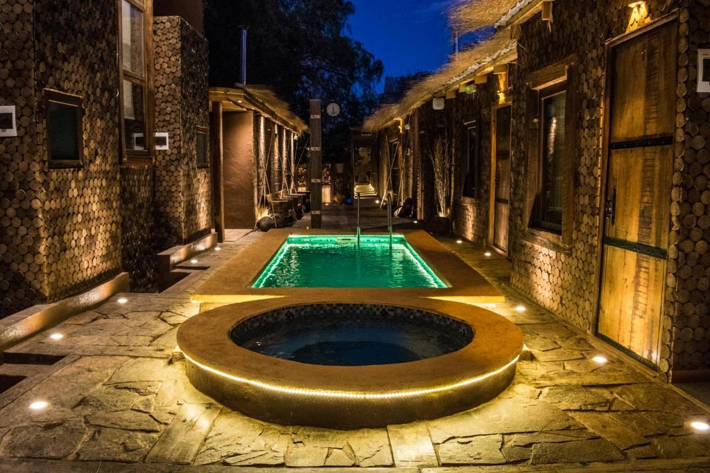 The swimming pool at or near Hotel la Estacion