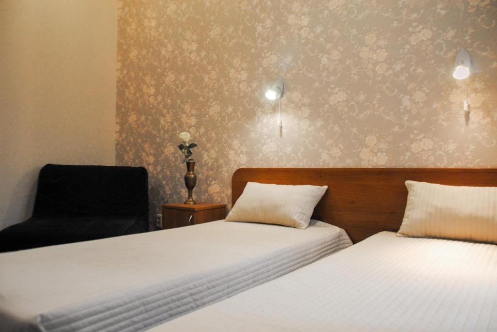 Кровать или кровати в номере Атмосфера на Большом 3
