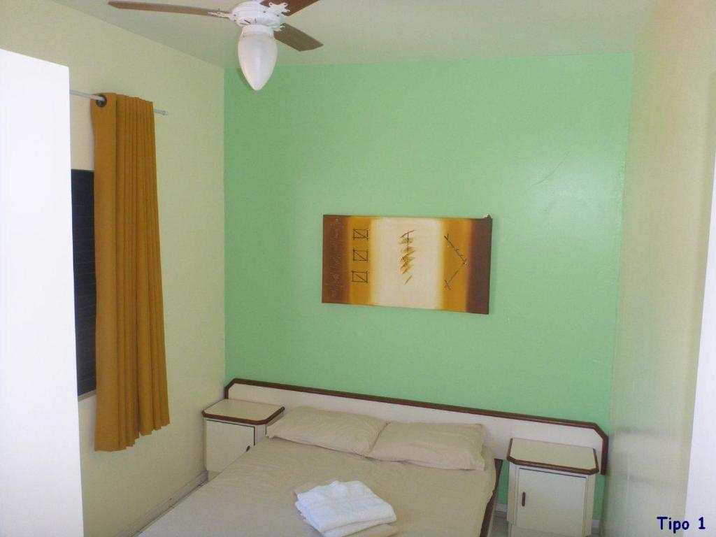 A bed or beds in a room at Residencial Ilhas Gregas
