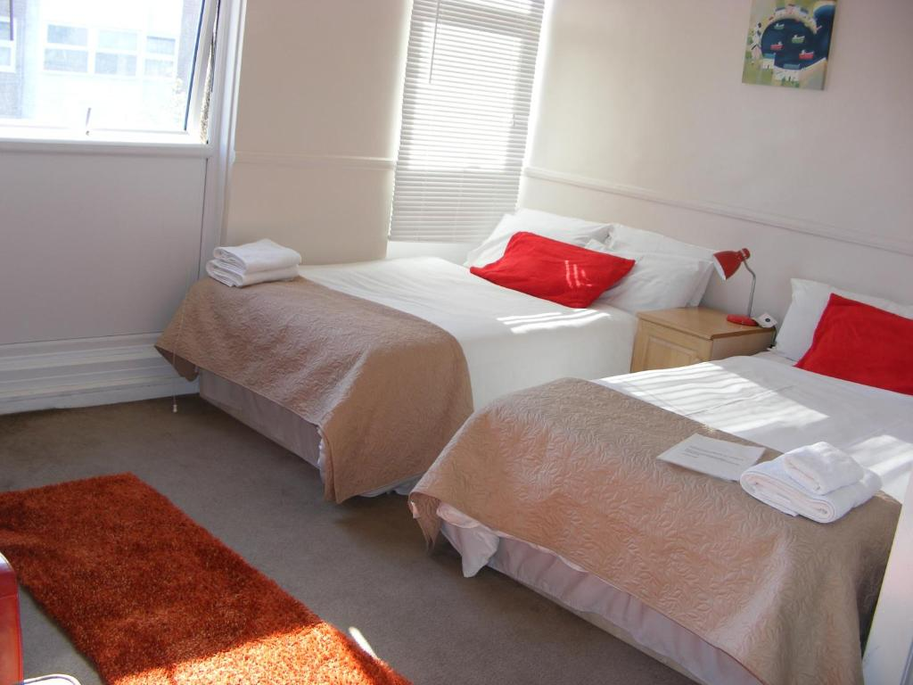 A bed or beds in a room at Myrtle 1st Floor Double Room