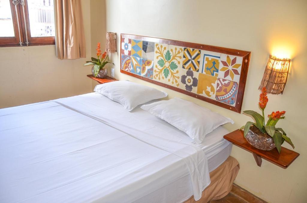 Pousada Fortal Villa Praia tesisinde bir odada yatak veya yataklar