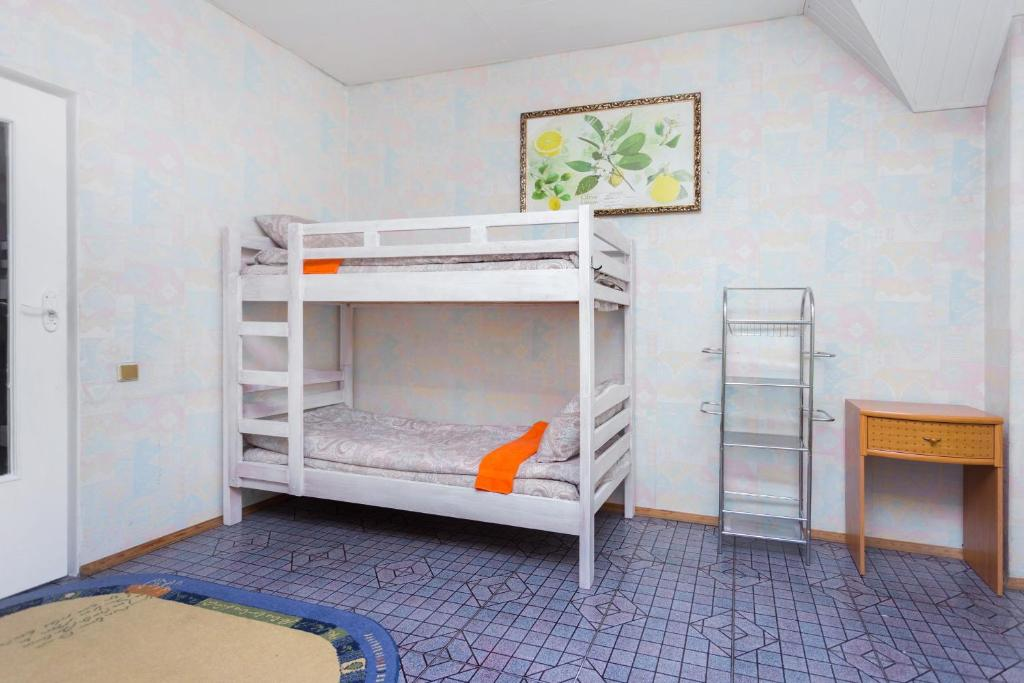 A bunk bed or bunk beds in a room at Hostel