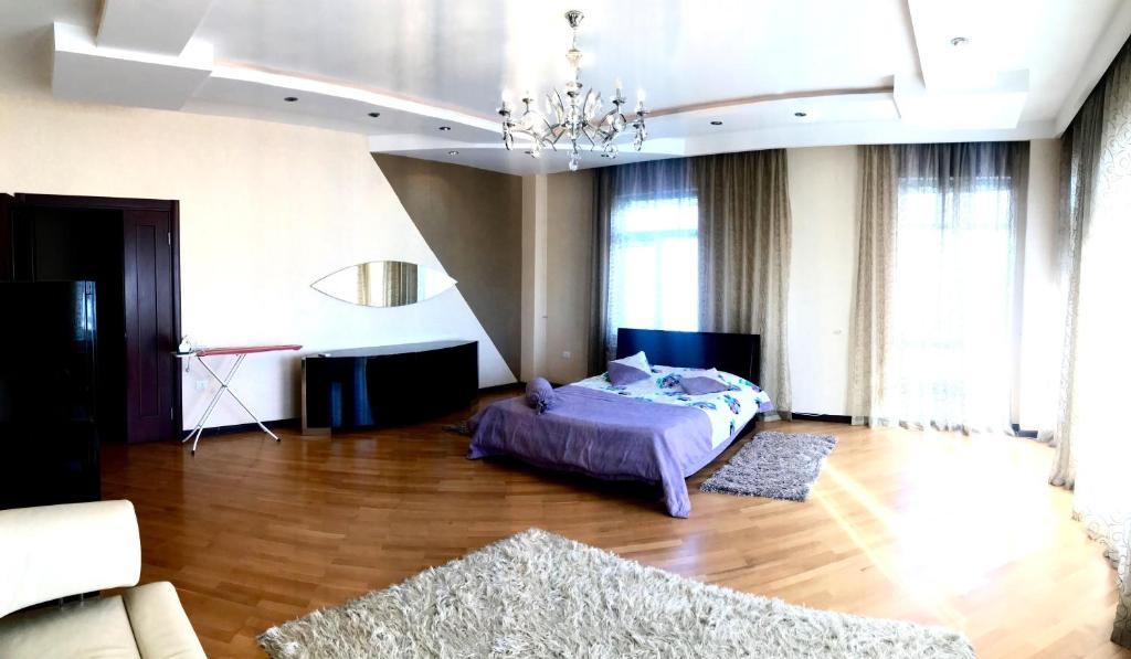 Кровать или кровати в номере Family home winter park