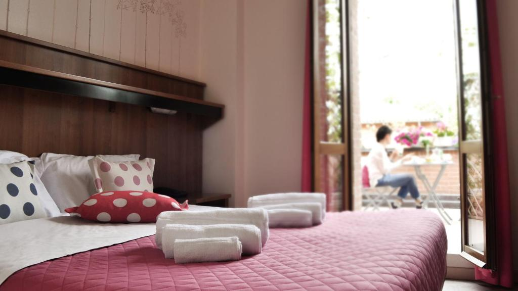 Letto o letti in una camera di Hotel EMI