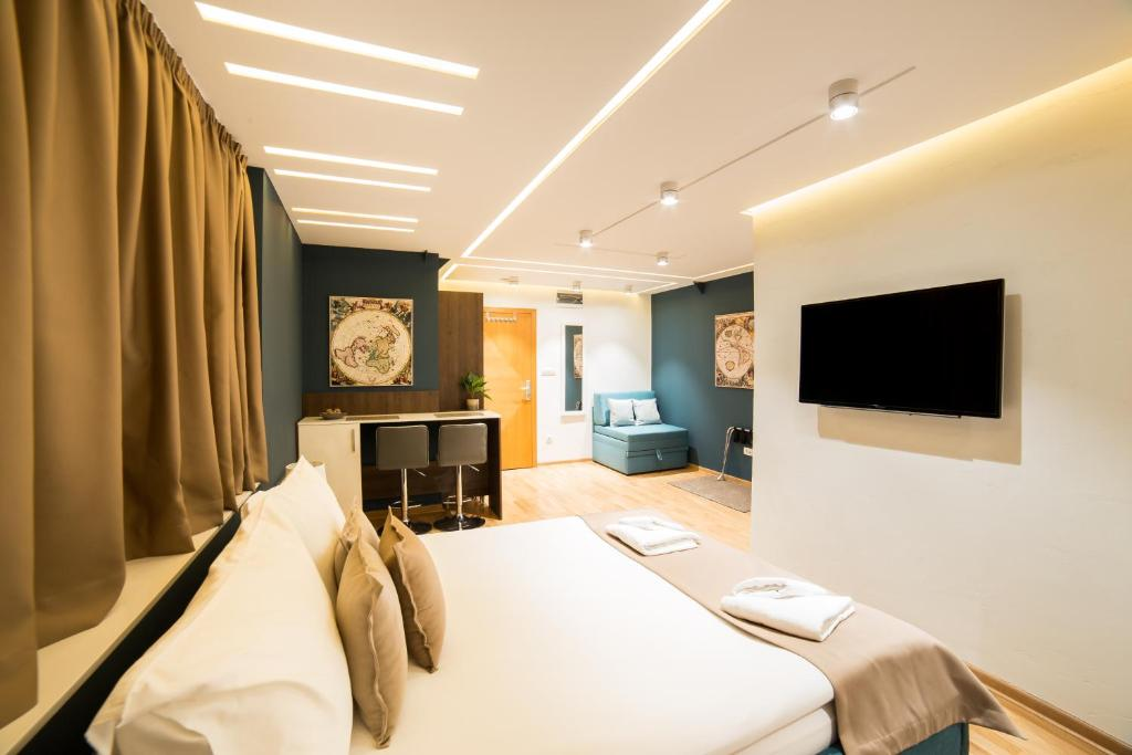 TV i/ili multimedijalni sistem u objektu Belgrade Center Luxury Apartments