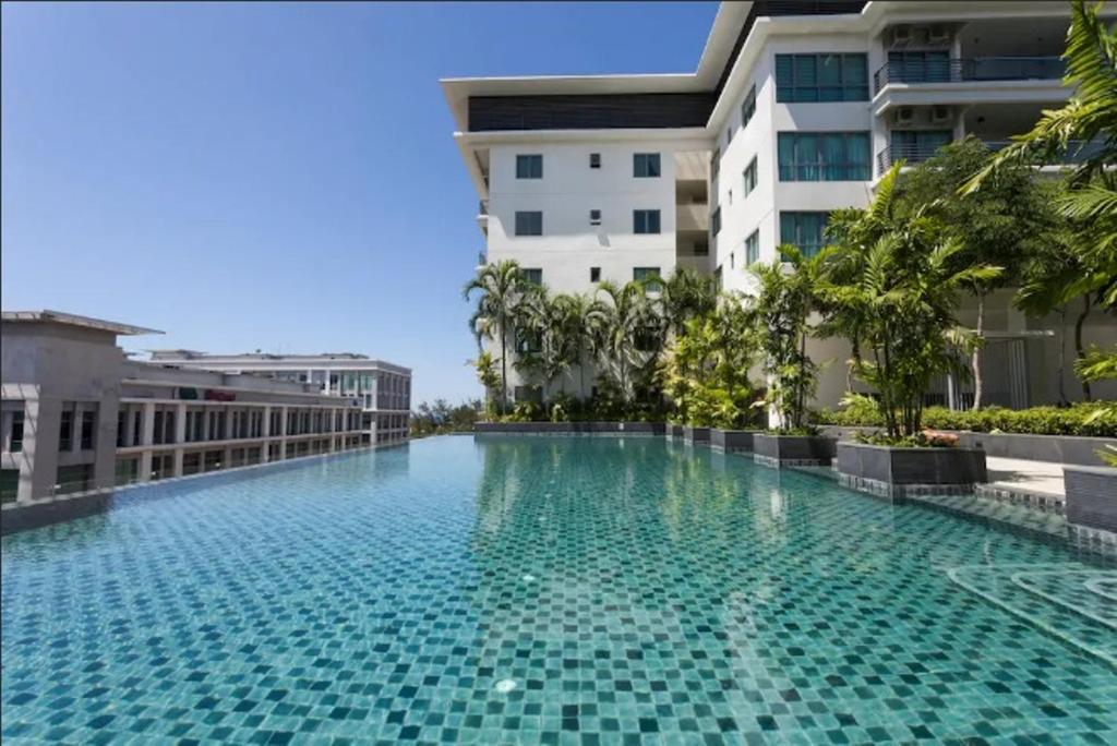 The Swimming Pool At Or Near Cozy 1 Bedroom Imago Ping Mall