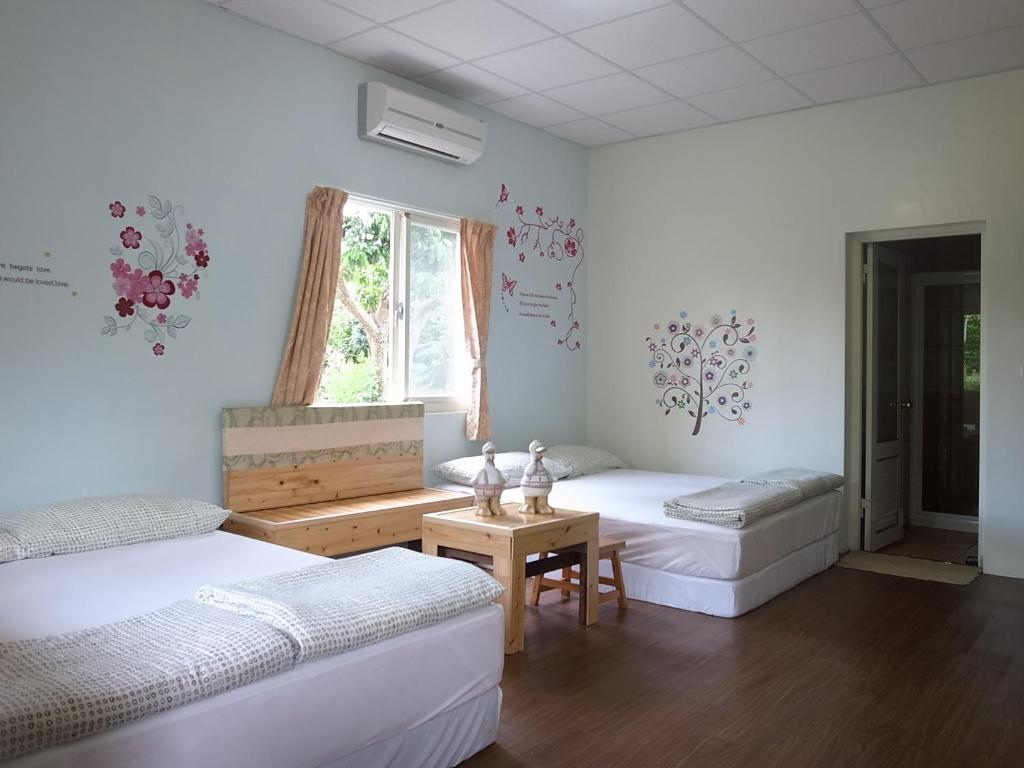 A bed or beds in a room at Ja Ja Homestay