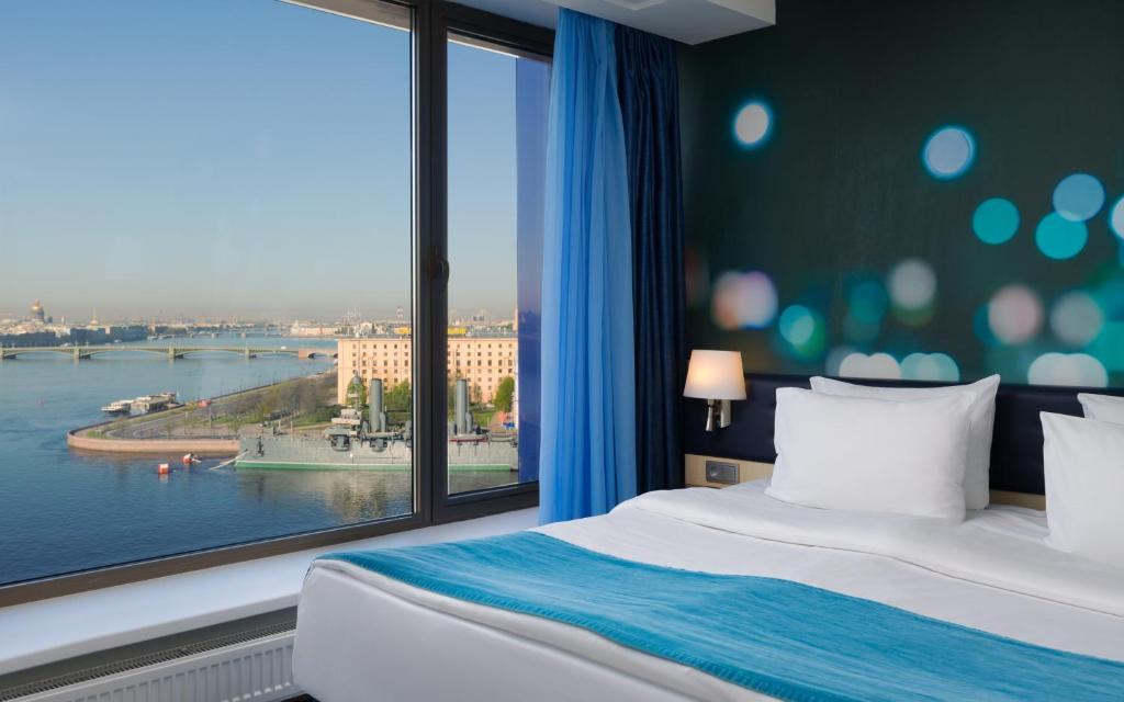 Кровать или кровати в номере Отель Санкт-Петербург