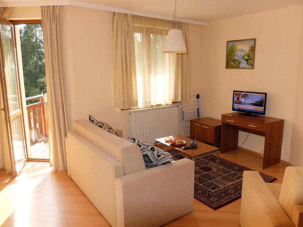 A seating area at Borovets Apartment, Villa Park