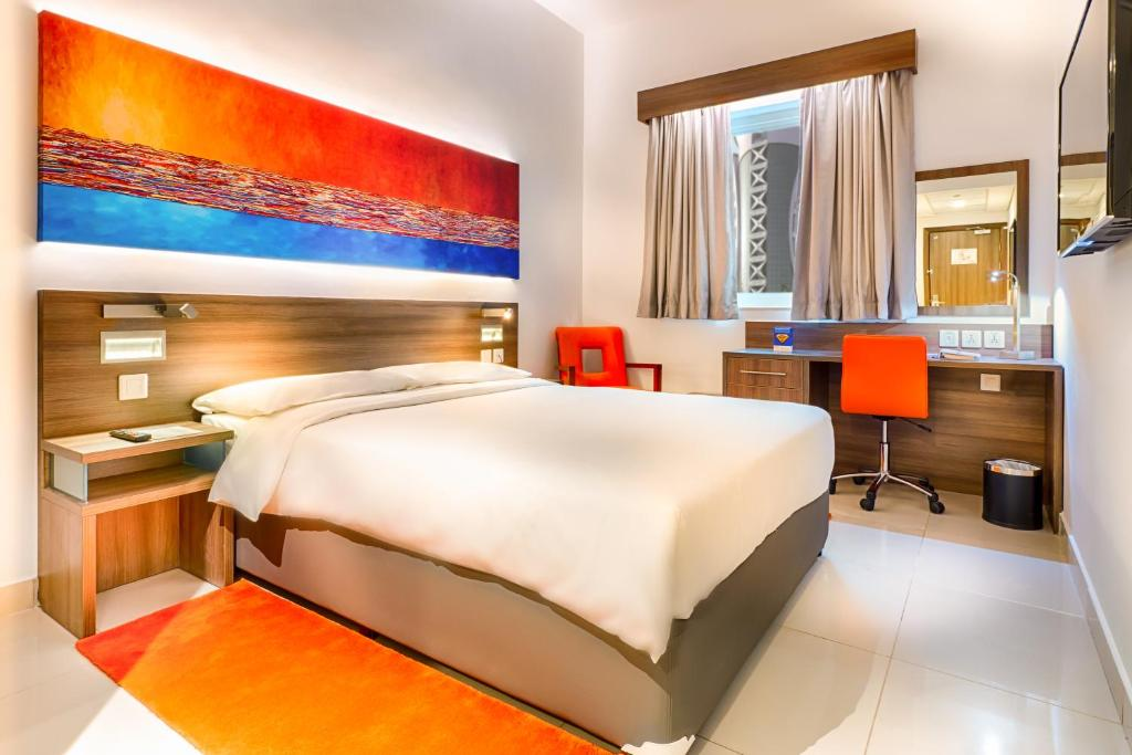 A bed or beds in a room at Citymax Hotel Bur Dubai