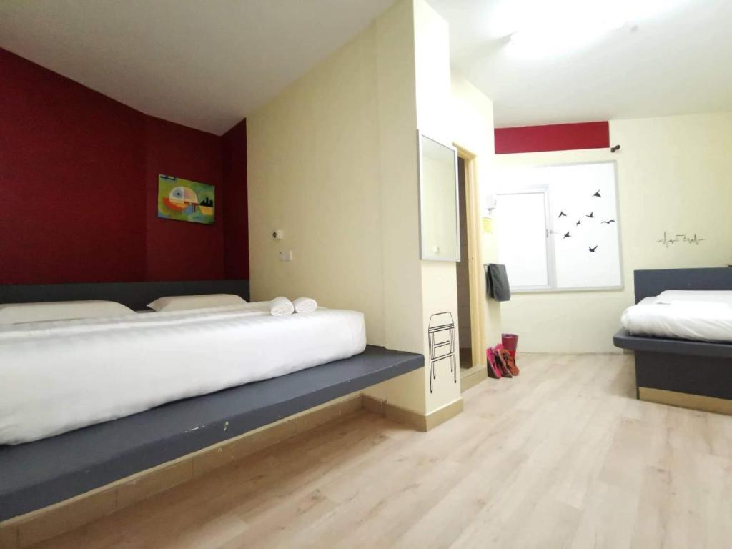 Katil atau katil-katil dalam bilik di Abby by the river
