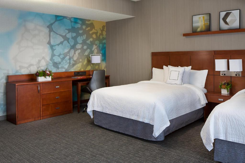 A Bed Or Beds In Room At Courtyard Grand Rapids Downtown