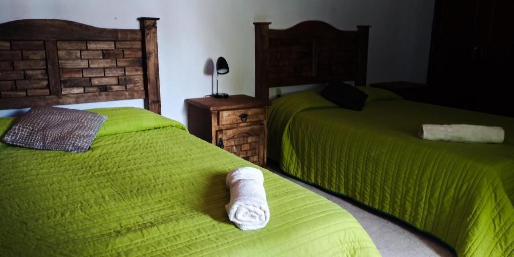 En eller flere senge i et værelse på Hostal Panda Viajero
