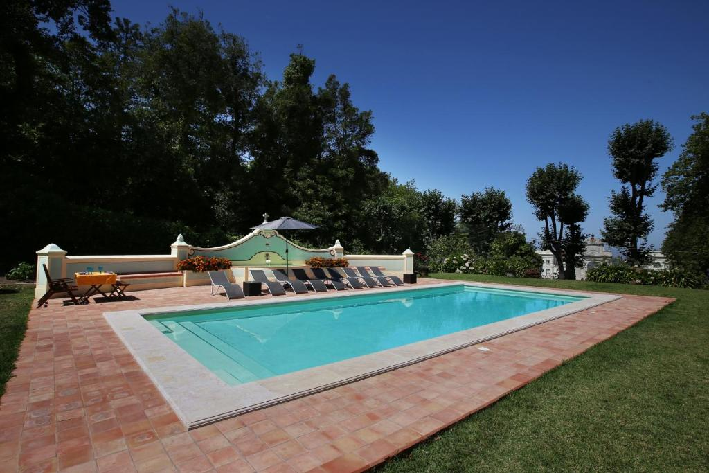 The swimming pool at or near Villa Cintra with Two Houses