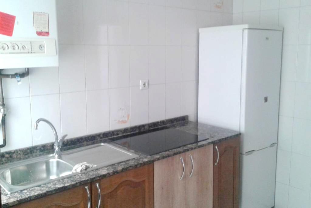 A kitchen or kitchenette at Apartment Av. Pérez Galdós