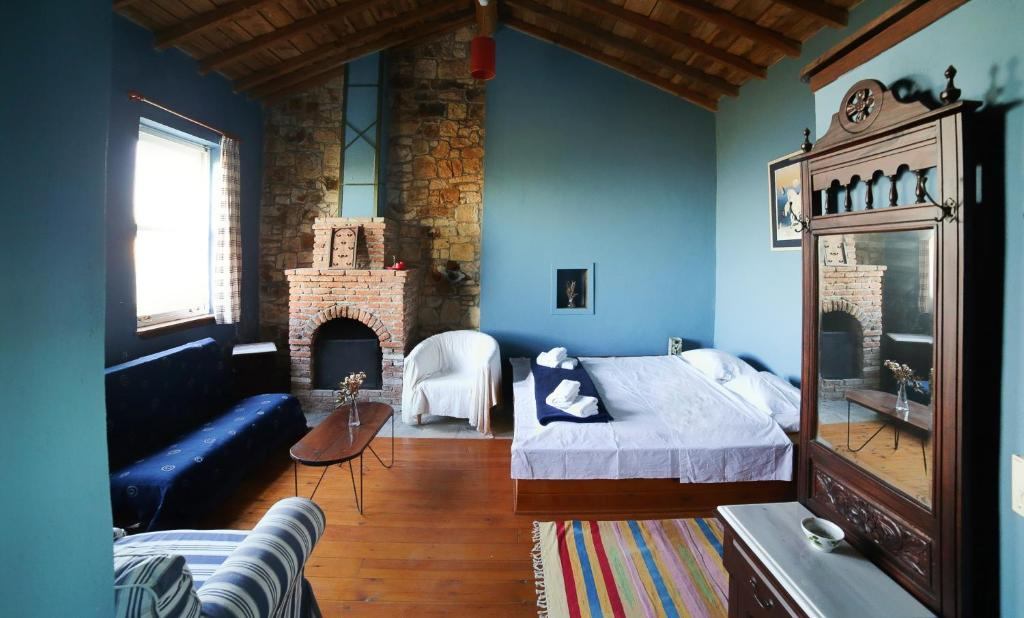 A bed or beds in a room at Toumba Eco Farm Guesthouses