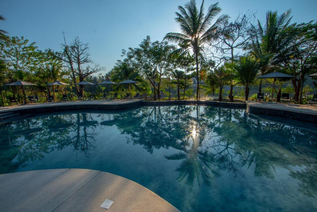 The swimming pool at or near Le Bel Air Resort Luang Prabang
