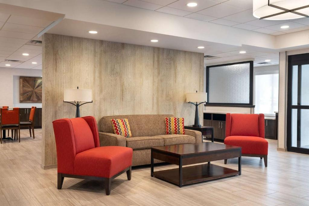 A seating area at Days Inn & Suites by Wyndham Denver International Airport