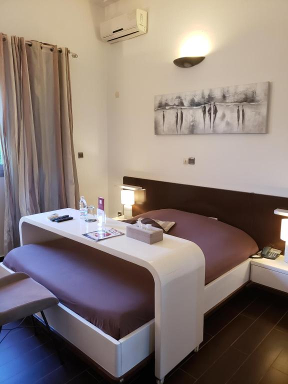 A bed or beds in a room at Villa Ayaba