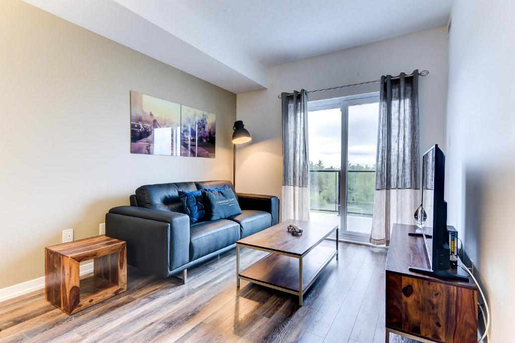 A seating area at Kanata Lakes Apartments by Corporate Stays