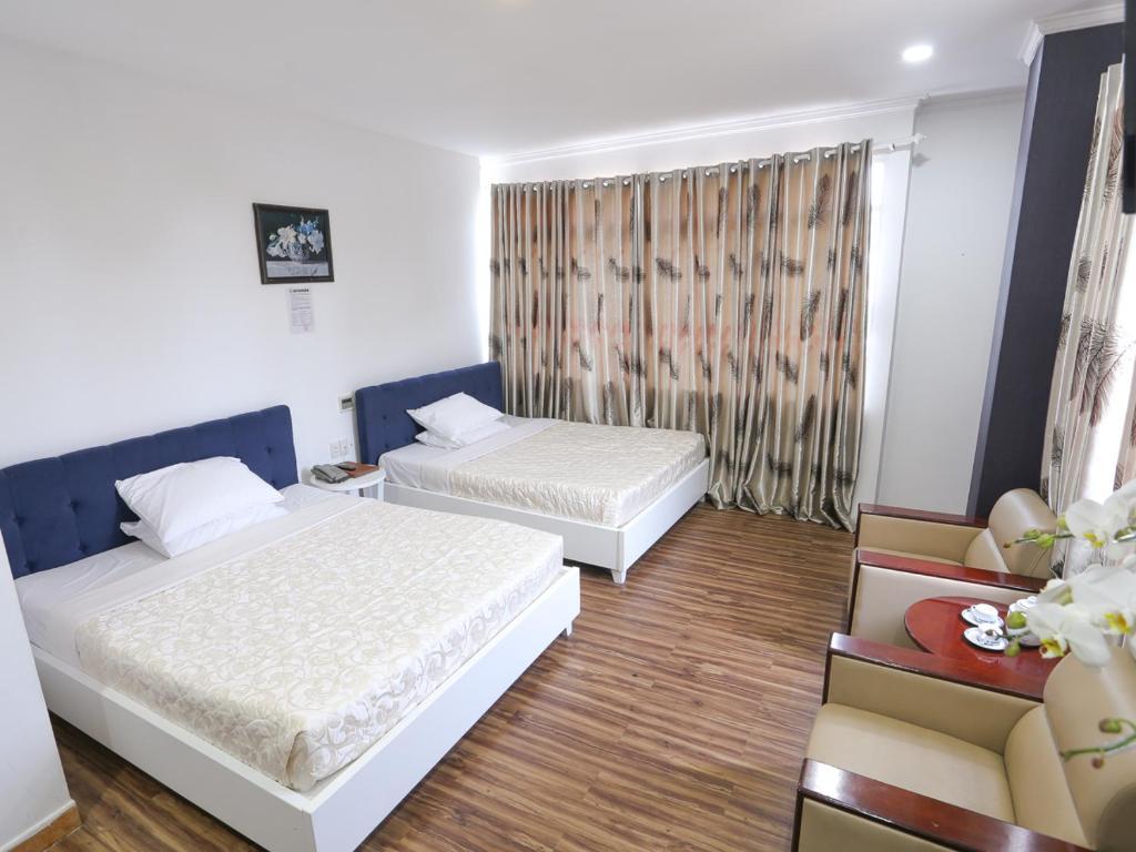 Кровать или кровати в номере Rainbow Hotel
