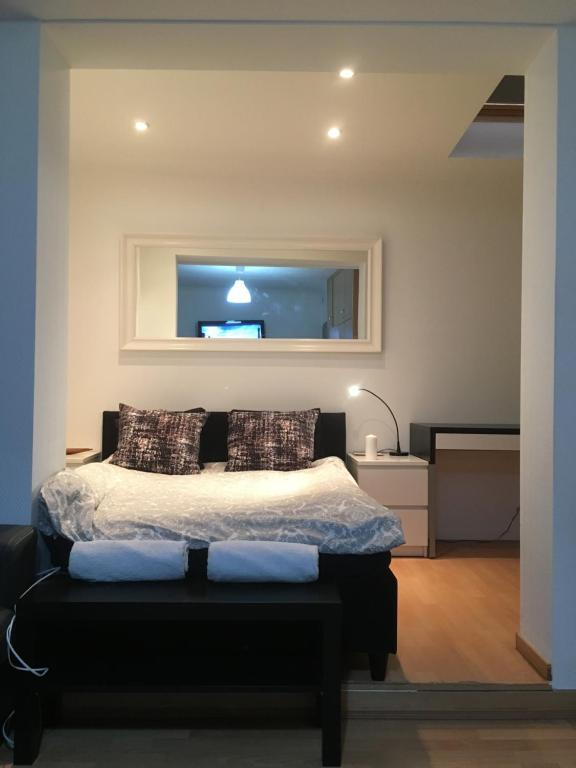 A bed or beds in a room at Standard Rooms in Center Esch-Alzette