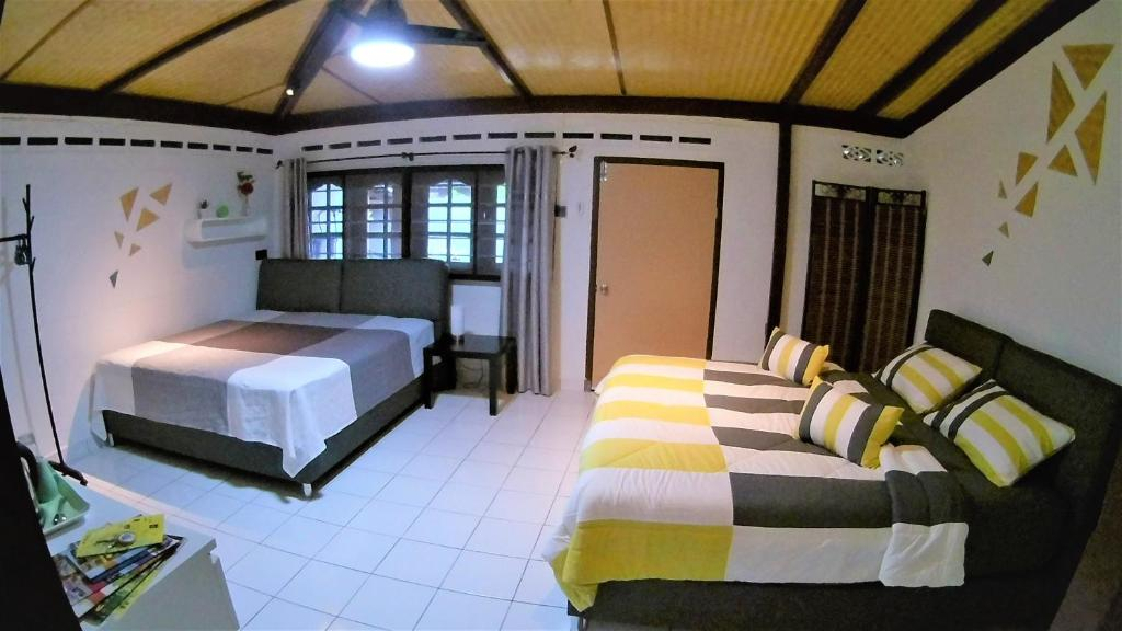 A bed or beds in a room at Sabandy House B&B