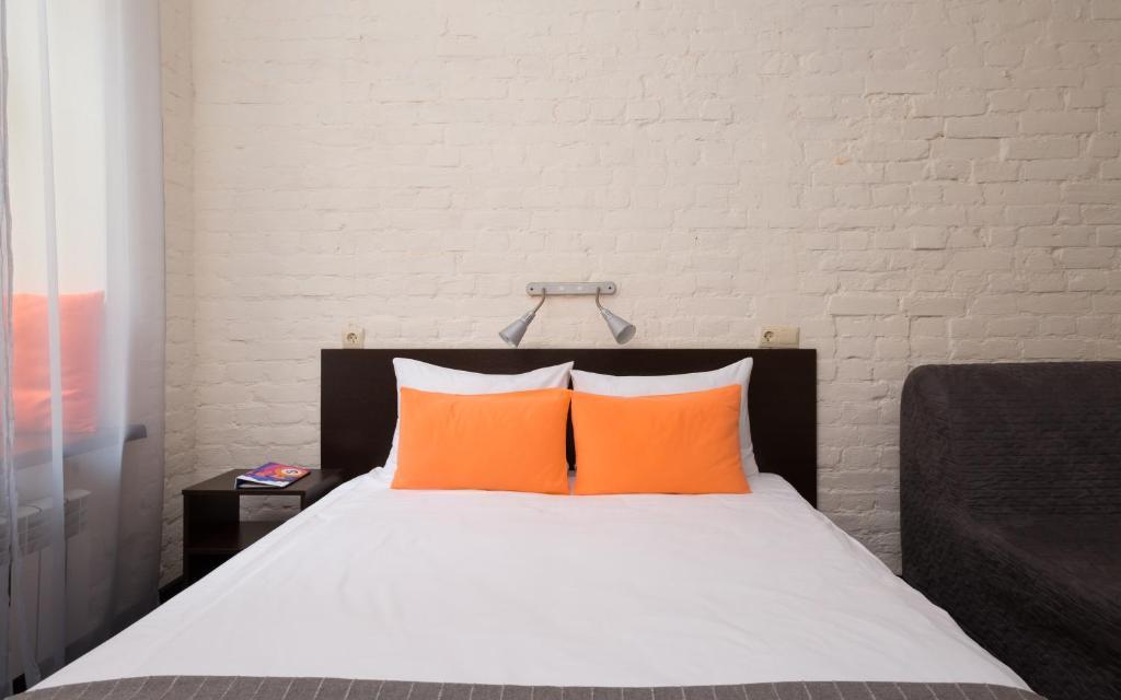 Кровать или кровати в номере Station Hotel S13